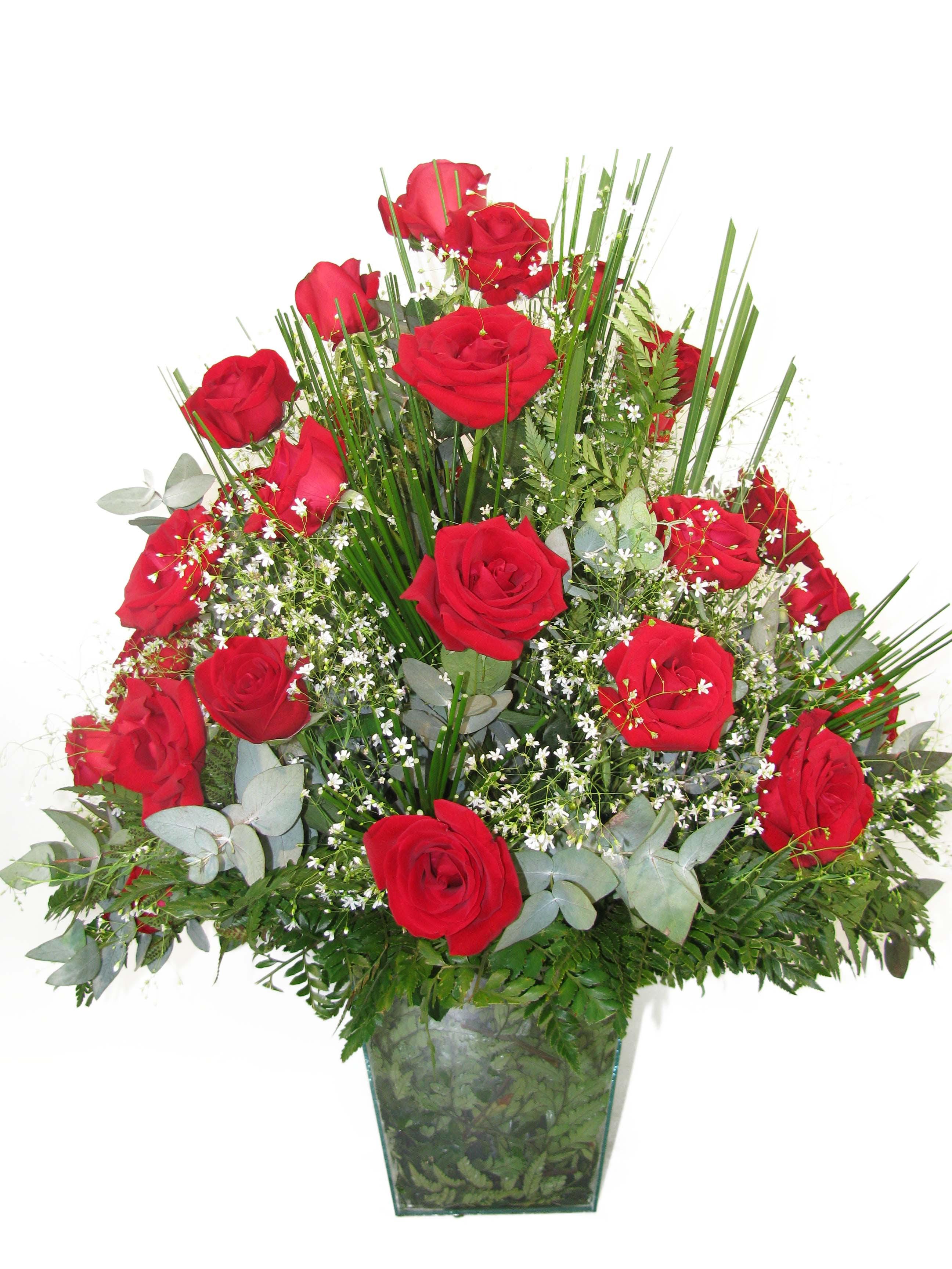 Aparador de rosas vermelhas para buffet.
